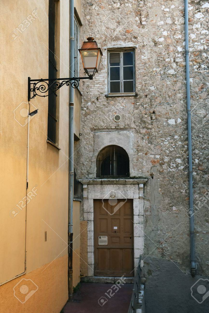 Old stone walls with door and windows, street lamp in the foreground, Nice, France Stock Photo - 3049663
