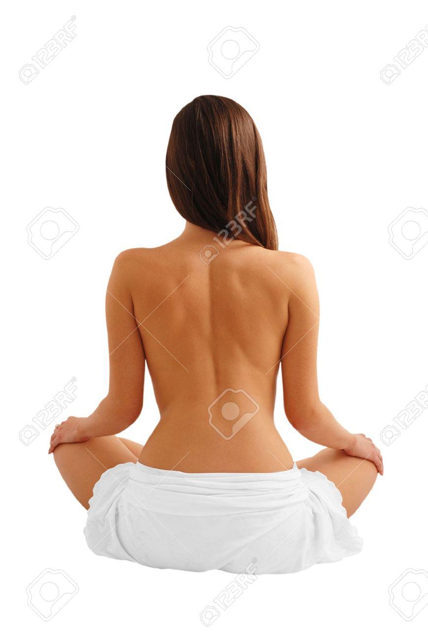Naked back of beautiful female model sitting as lotus, palms on knees, isolated on white Stock Photo - 3750276