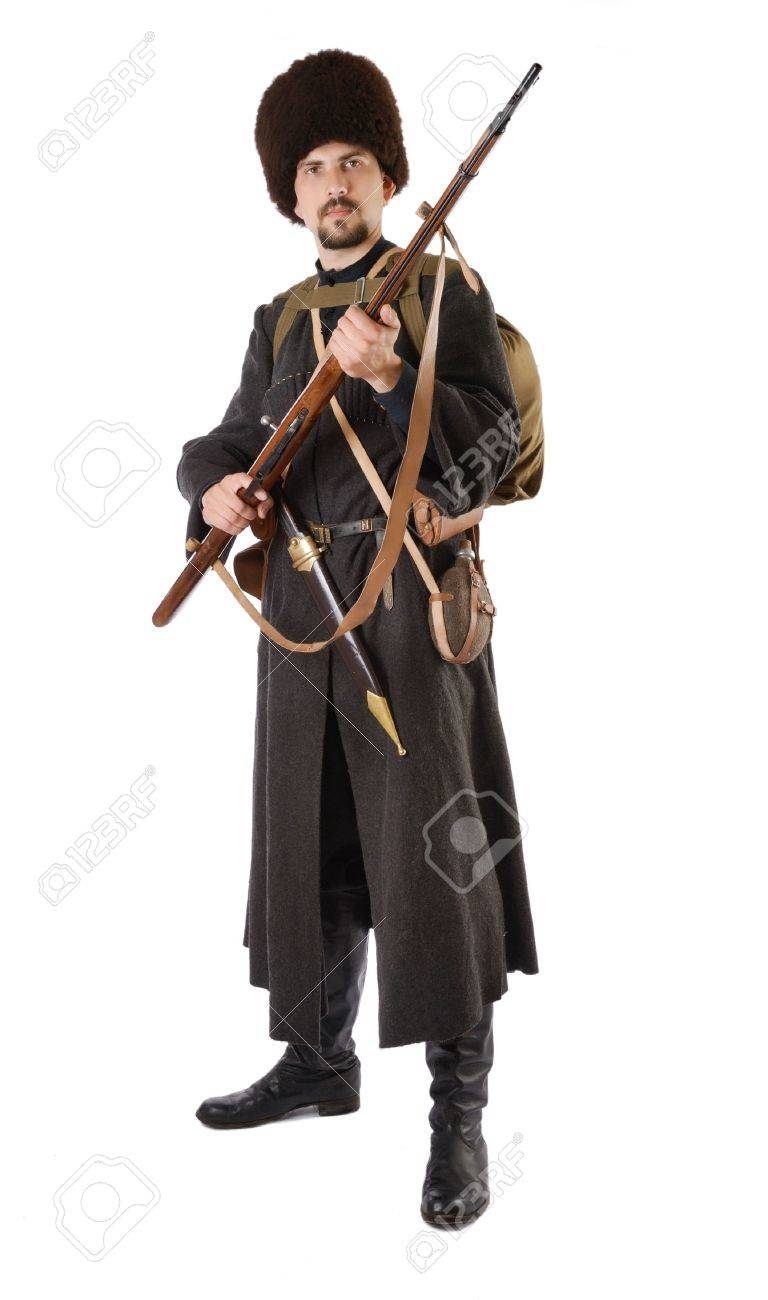 Young man is wearing vintage uniform of Russian foot Cossack