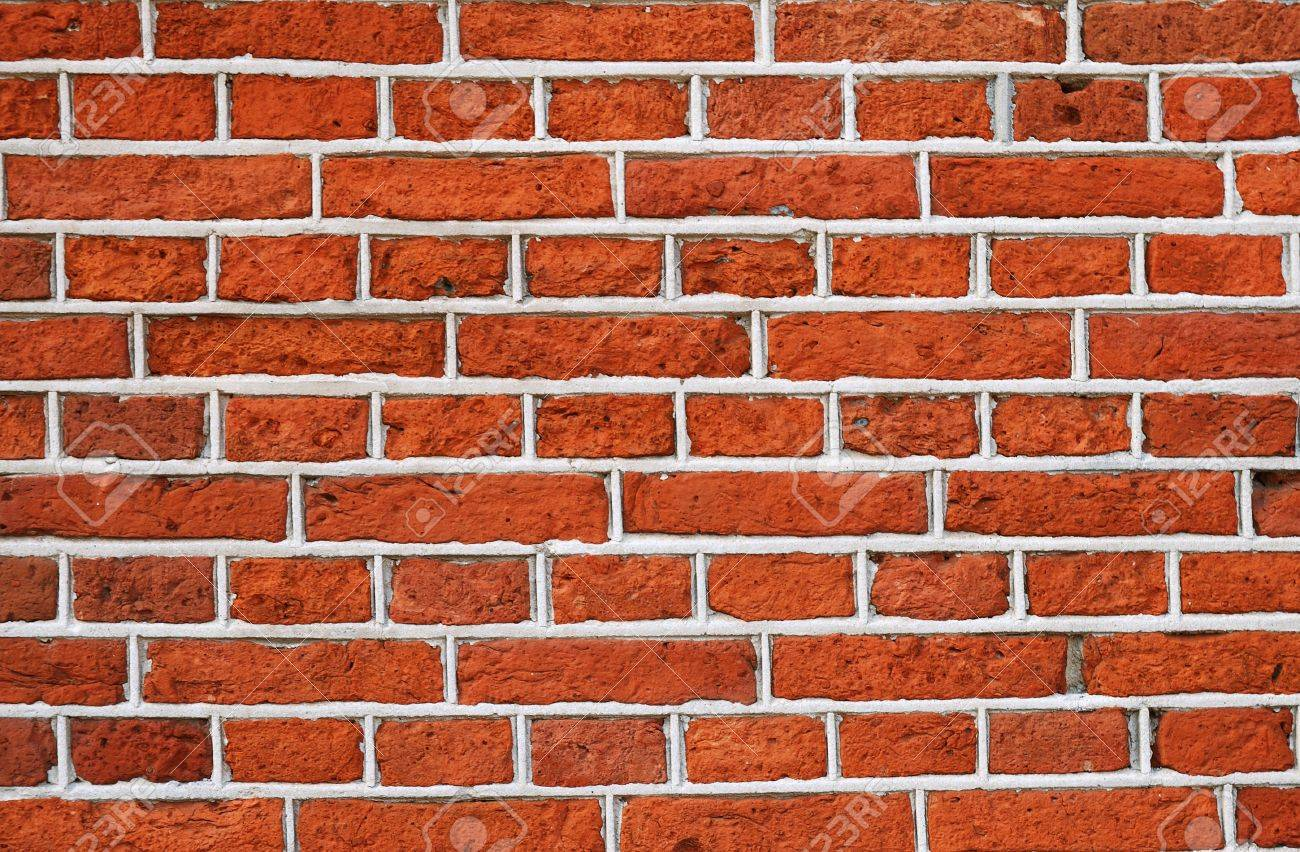 brick wall is made of various material it has shades of red