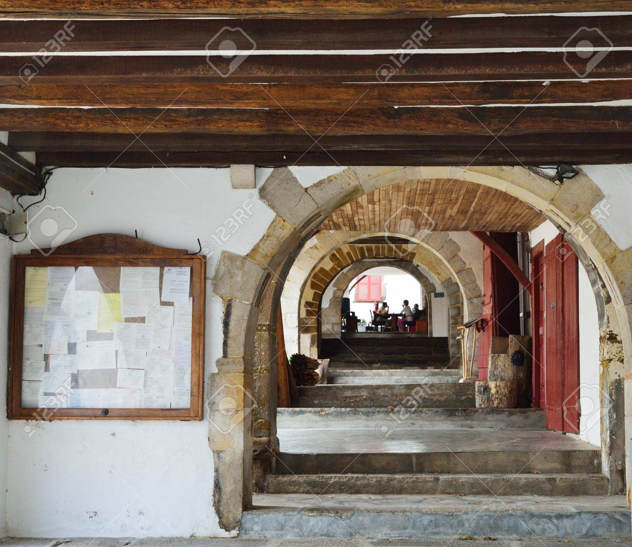 an enfilade of the arches and a stone staircase are in the terrace