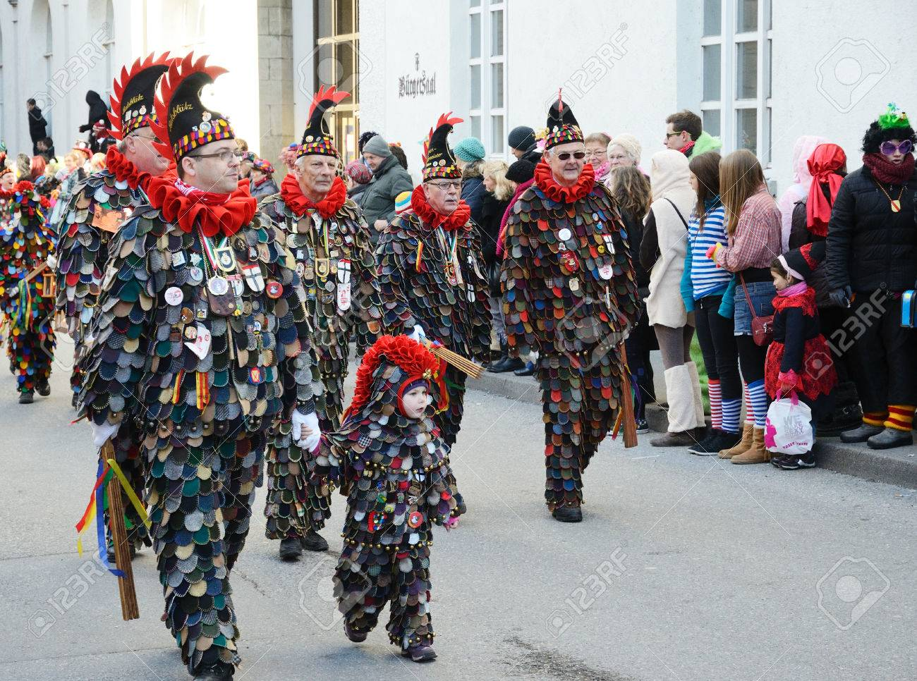 mummers in costume of narro are stalking along the street of