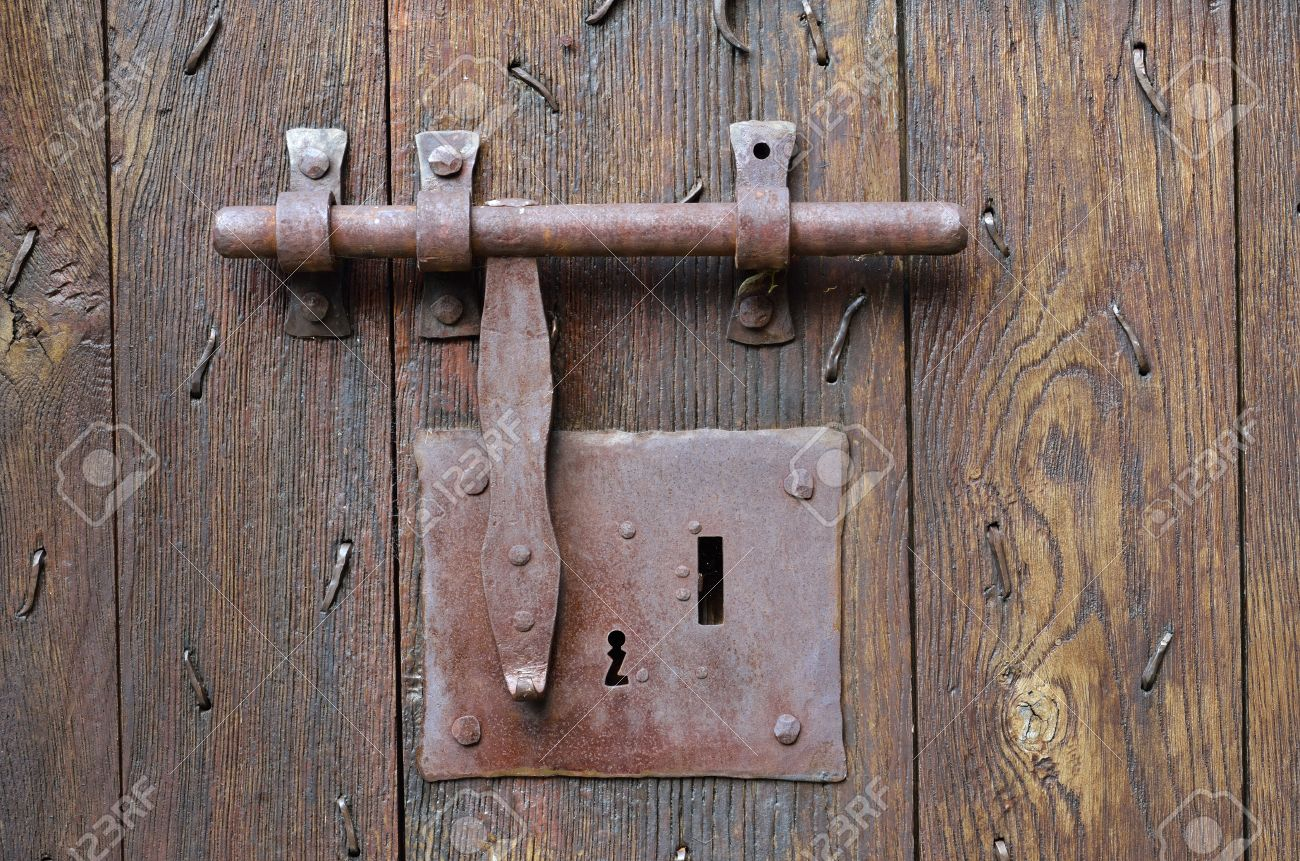 The big metal lock with a latch on the wooden surface of the ancient batten door & Batten Doors Stock Photos \u0026 Pictures. Royalty Free Batten Doors ...