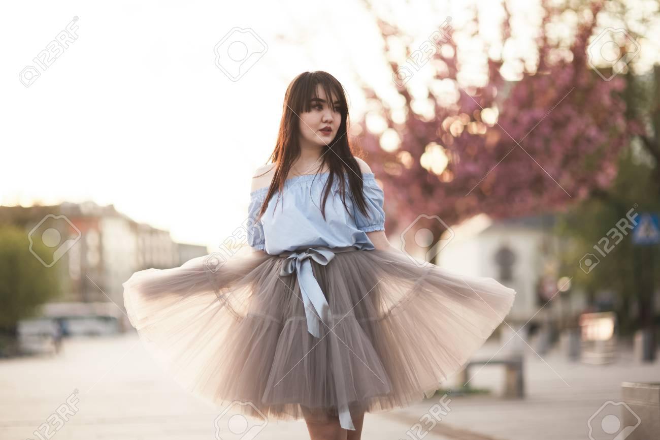 Stock Photo - Young Asians girl with modern dress posing in an old Krakow.
