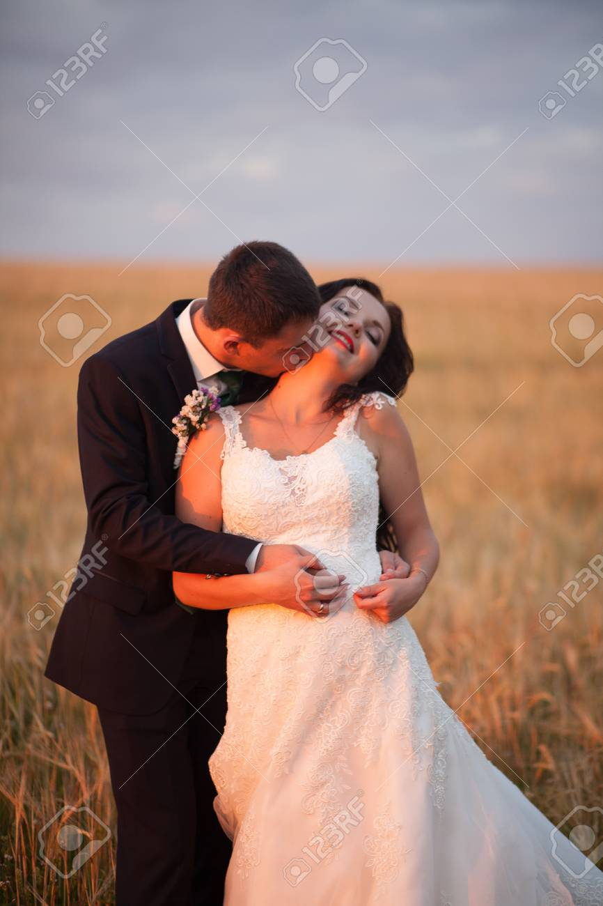 Beautiful Romantic Wedding Couple Of Newlyweds Hugging In Park Stock Photo Picture And Royalty Free Image Image 57844894
