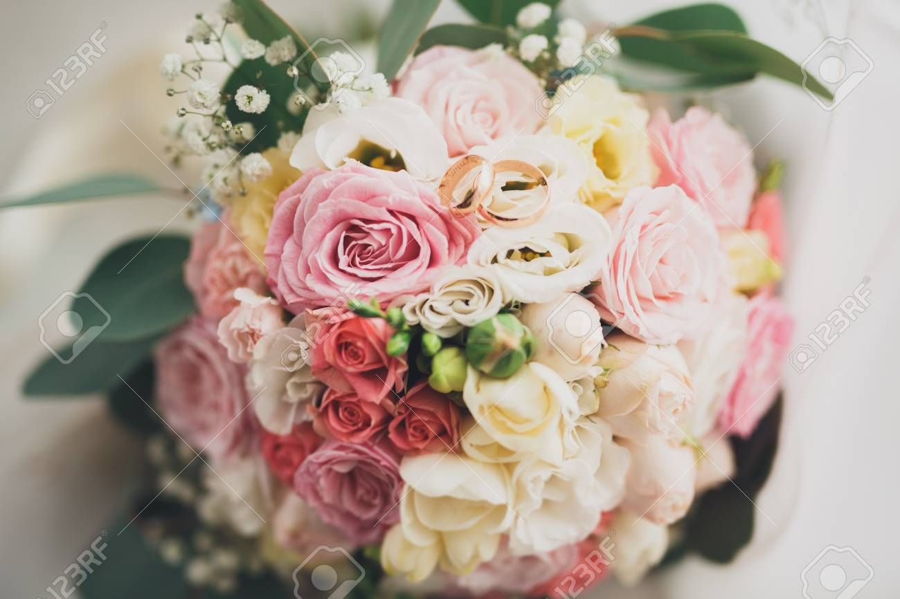 Pretty Good Wedding Bouquet Of Various Flowers With Rings Stock