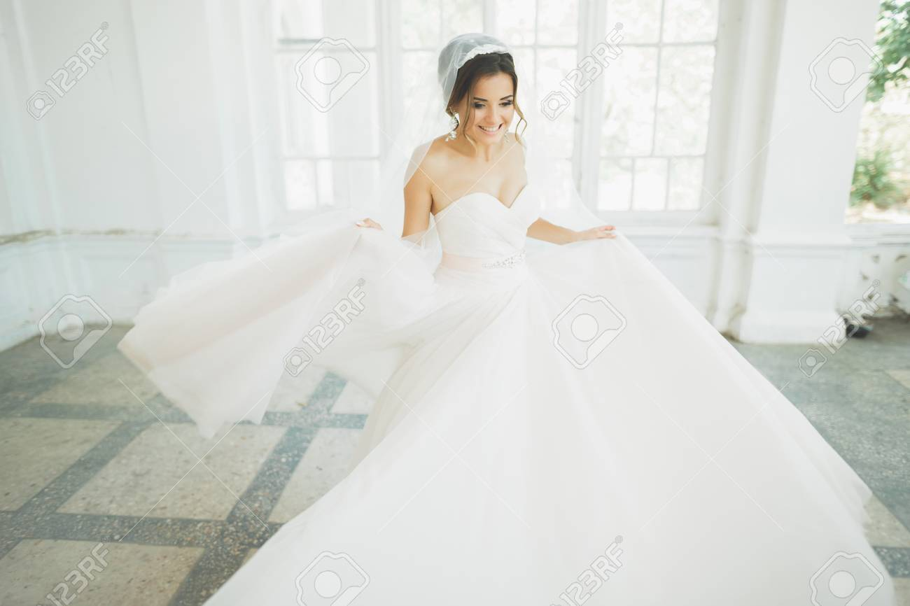 Beautiful Bride In Wedding Dress With Long Full Skirt White Stock