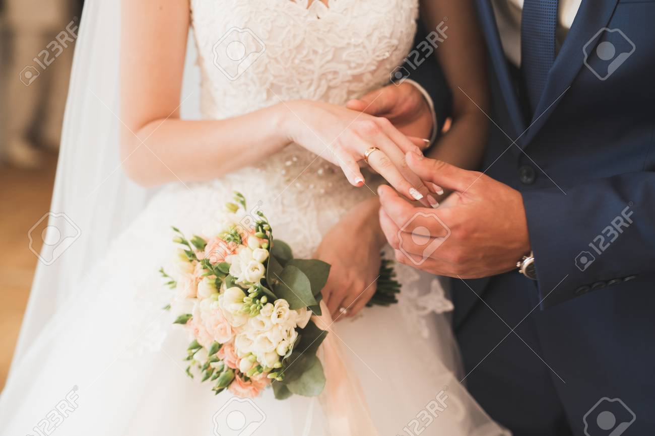 Bride and groom exchanging wedding rings. Stylish couple official ceremony - 101371446