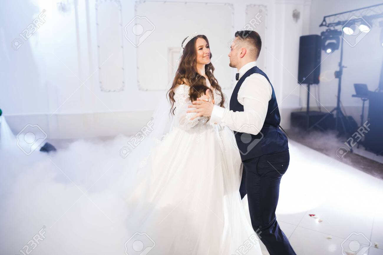 Beautiful wedding couple just married and dancing their first dance - 154906679