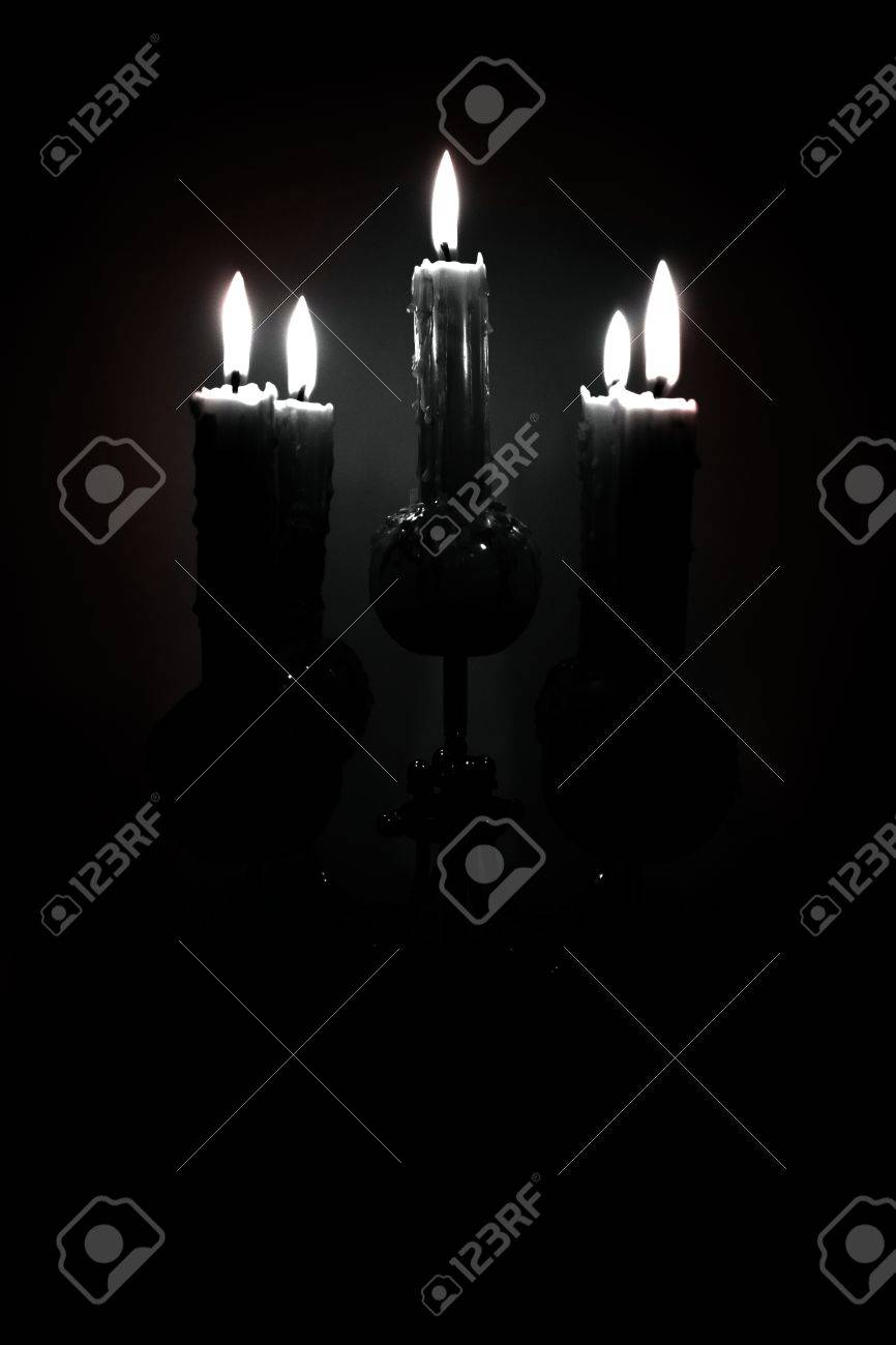 Candle Holder With Lit Candles In A Dark Room Stock Photo Picture