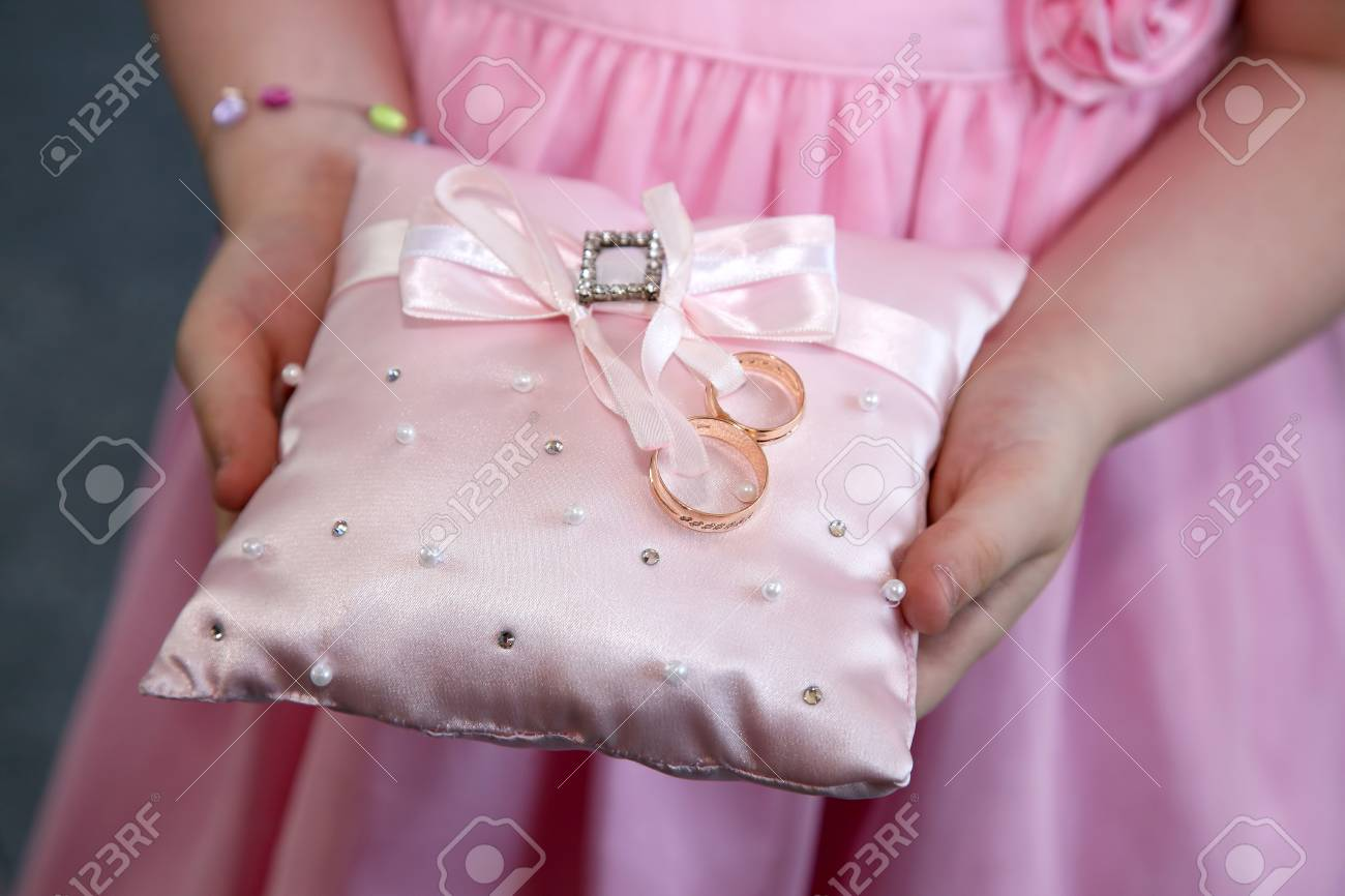 Bridesmaid Holds A Decorative Cushion With Wedding Gold Rings Stock ...