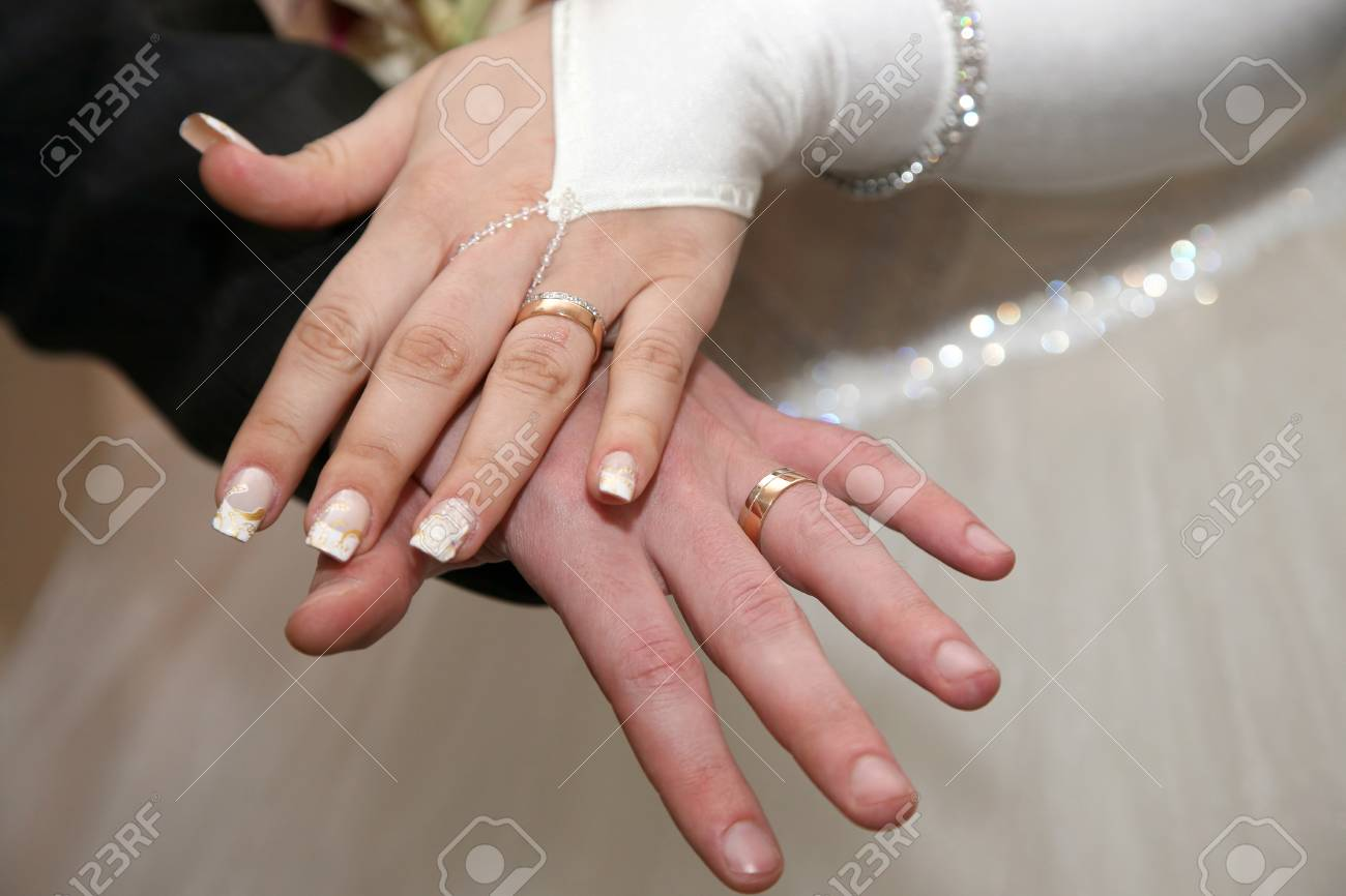 Bride And Groom Show Their Hands Wearing Wedding Rings Stock Photo ...