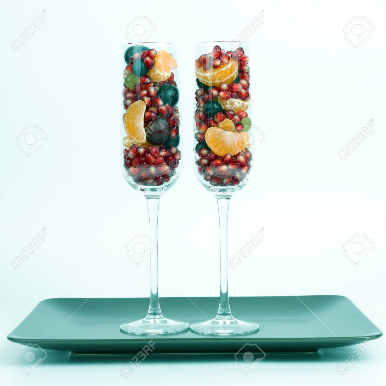 two glasses filled with fruit on a light background. healthy fresh vegetables and food - 125138691