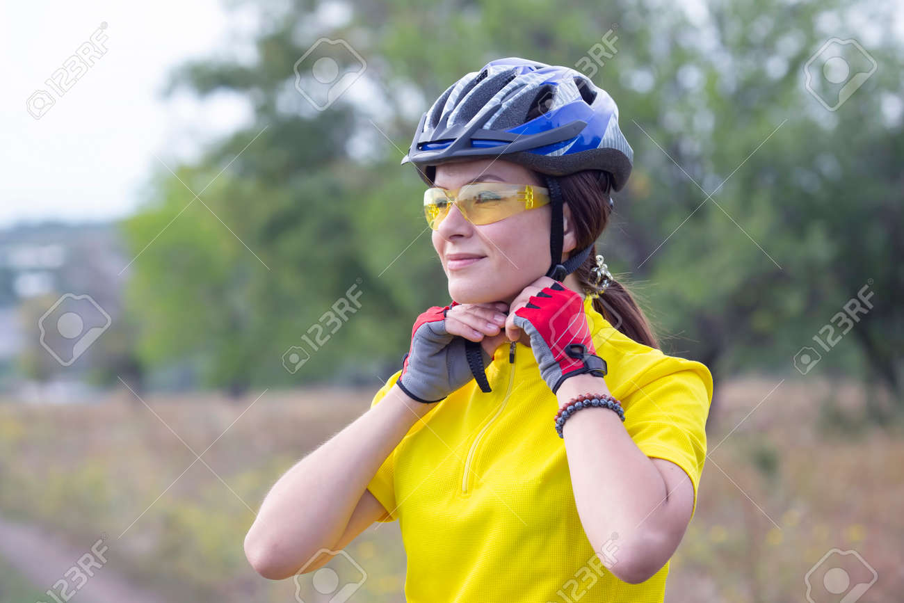 Beautiful and happy girl cyclist on nature. Healthy lifestyle and sports. Leisure and hobbies - 153320218