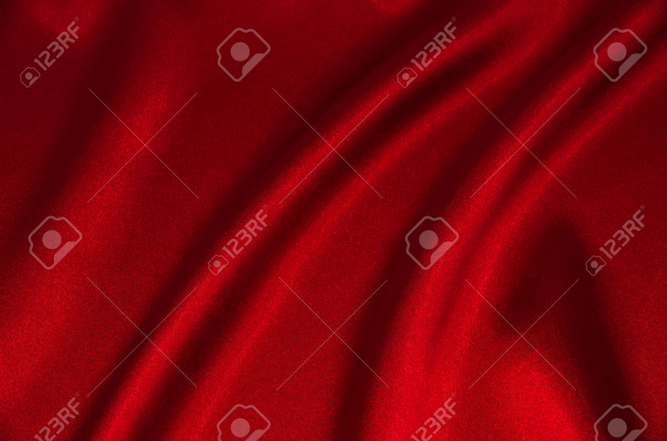 red satin or silk fabric as background - 169605457