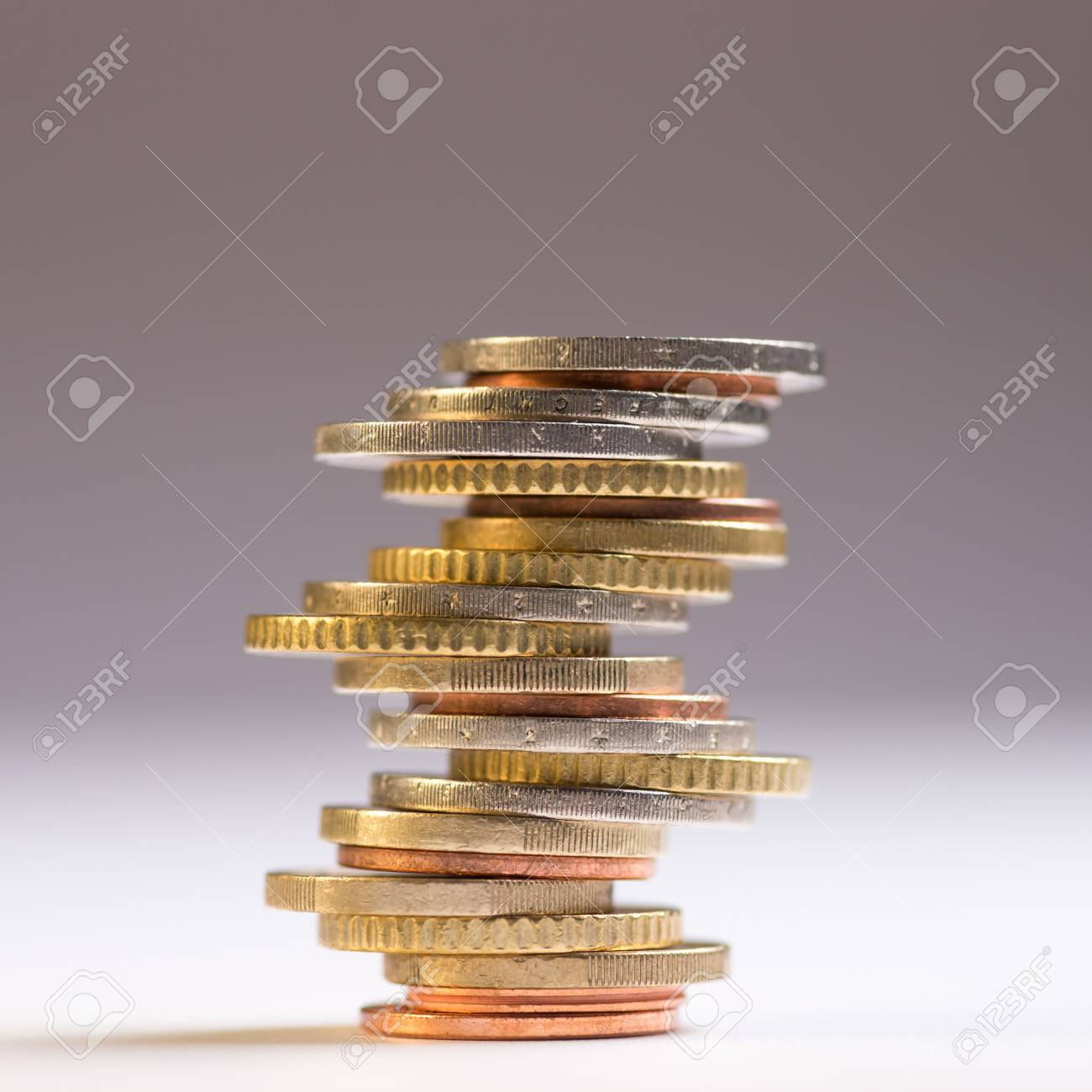 Euro coins stacked on each other in different positions. Copy space for text - 120600944