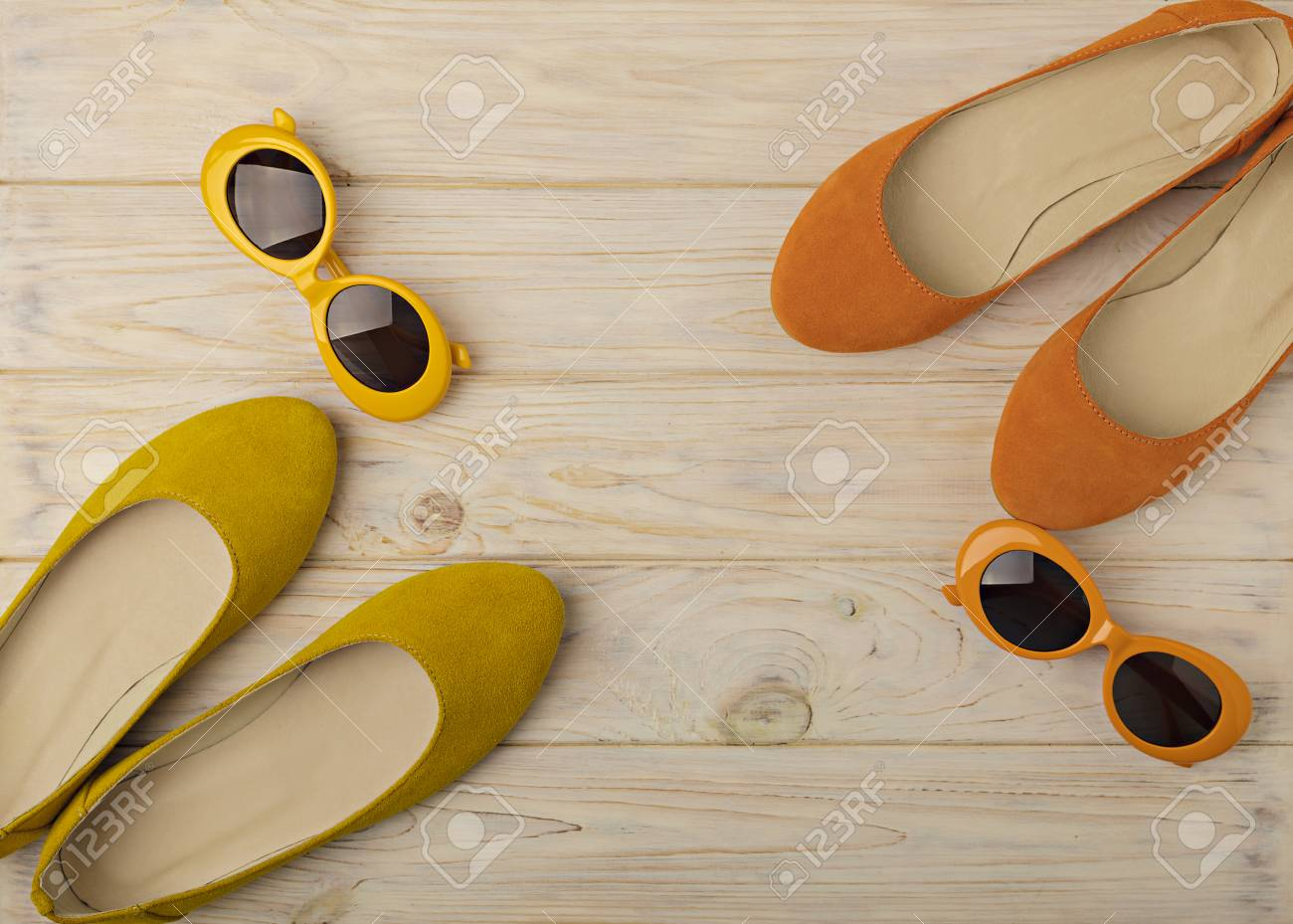 fc2e01097942 Stock Photo - Women s ballet flats and sunglasses are yellow and orange  color. Selective focus.