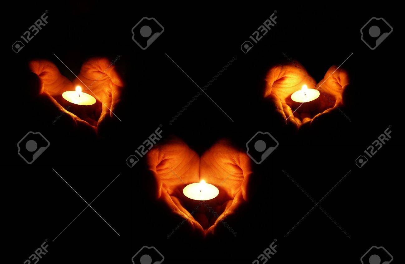 three couples of heart-shaped palms with candles on black background Stock Photo - 2345478