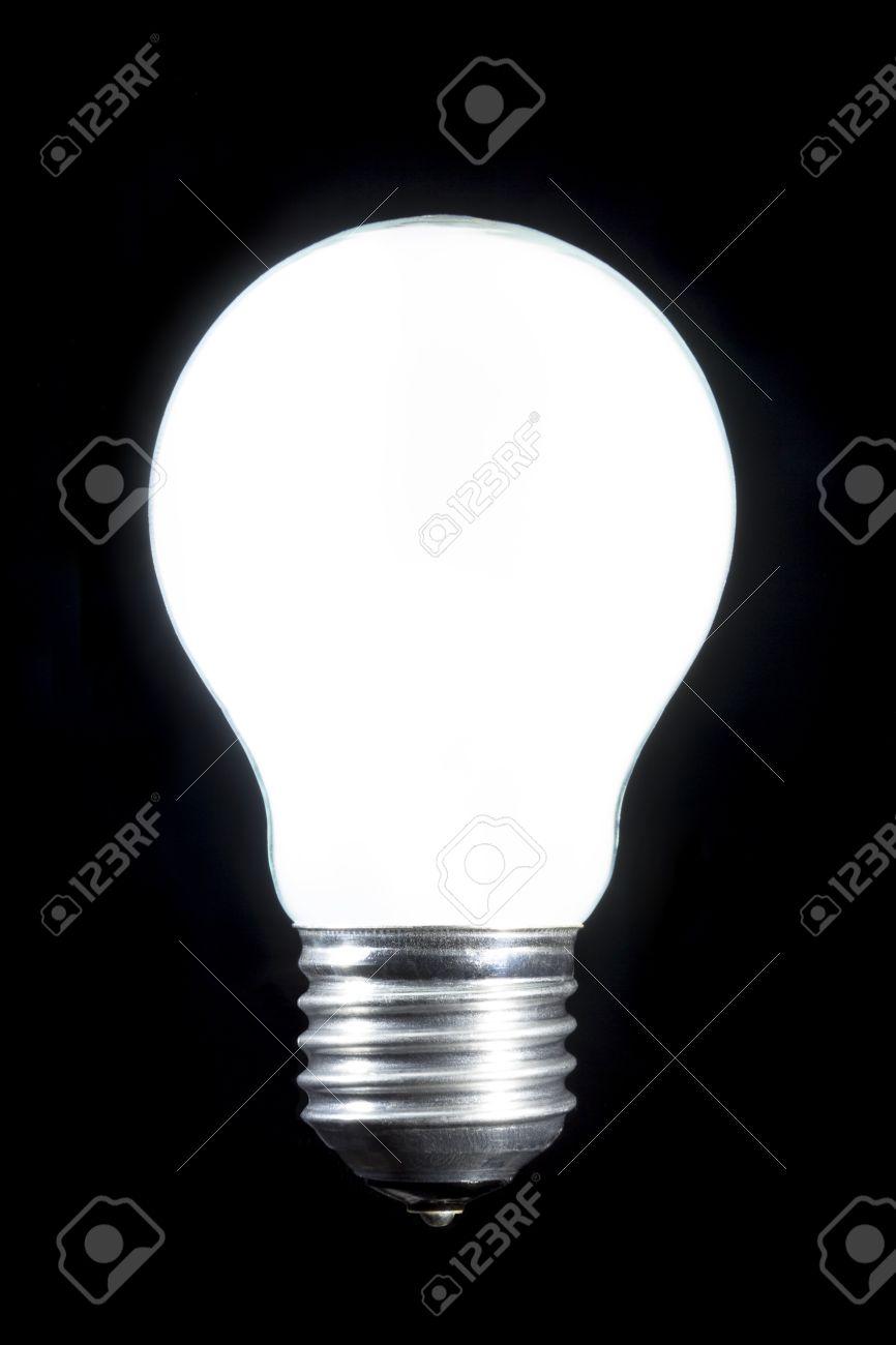 Burning Bright White Light Bulb On Black Background Stock Photo