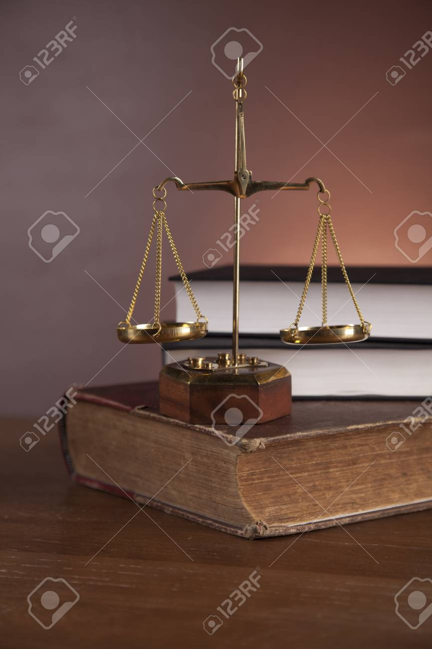 Scales of justice with ambient light Stock Photo - 16114427