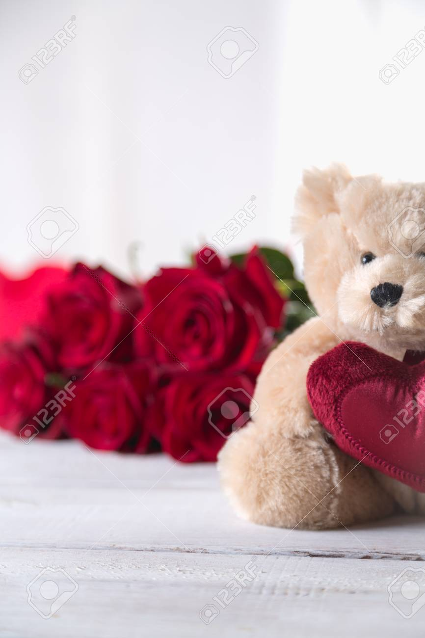 Cute Valentines Teddy Bear With Red Roses Love Concept Stock Photo
