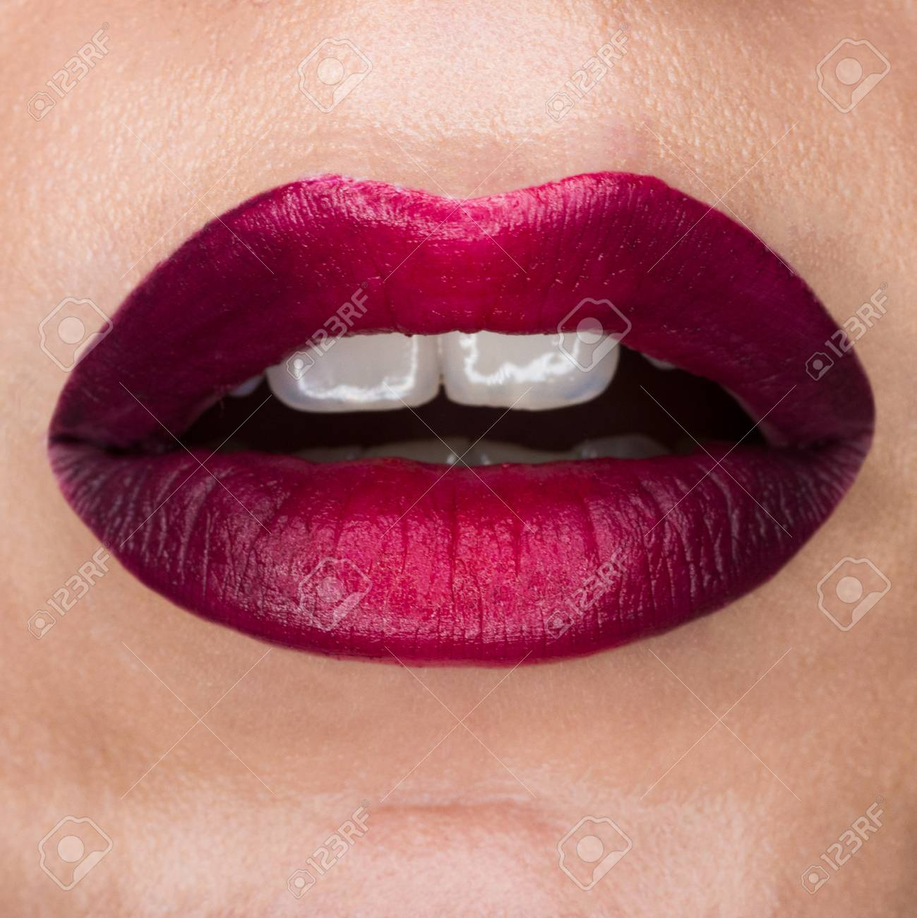 Close-up macro beautiful lips with red mat lipstick. Red gradient, white teeth and open mouth. Lip art - 126335726