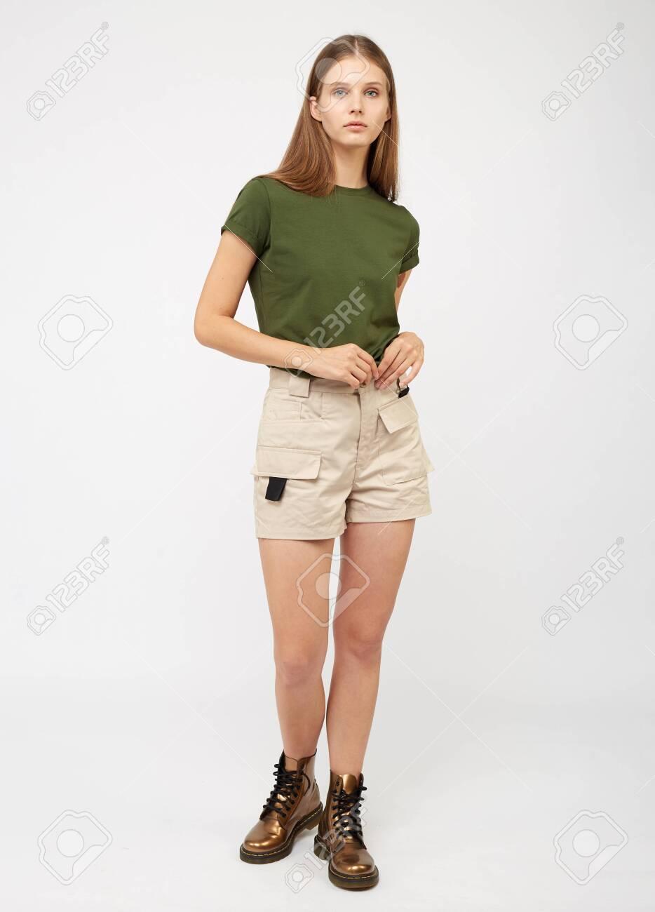 Teenager girl in beige cargo shorts - 133006184