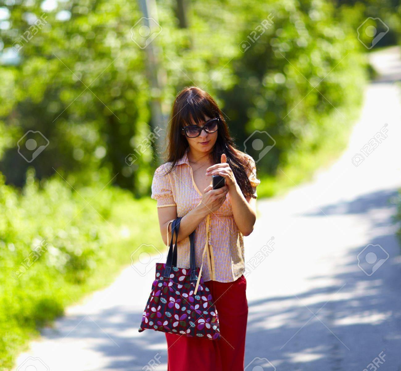 Girl walking the street Stock Photo - 8999647