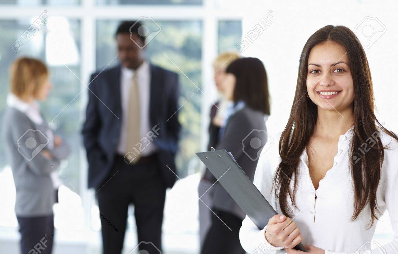 Happy cute businesswoman with colleagues in the background Stock Photo - 9067859