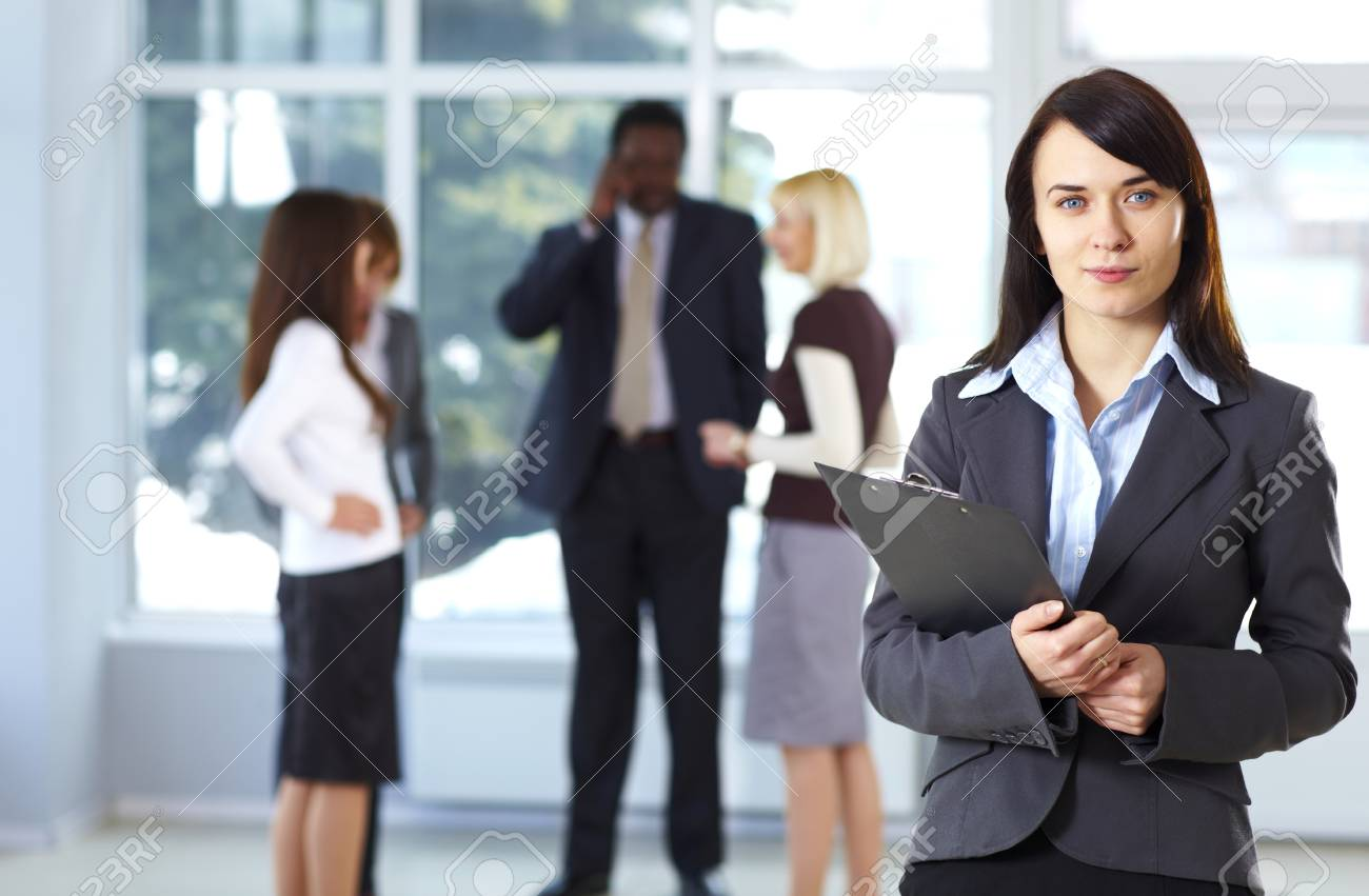 Happy cute businesswoman with colleagues in the background Stock Photo - 9067854