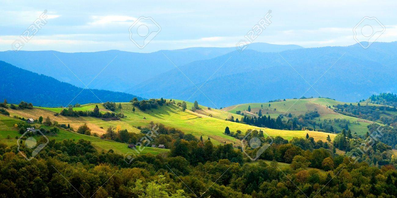 Ukrainian tranquil autumnal landscape with meadow and mountains. Stock Photo - 7924946