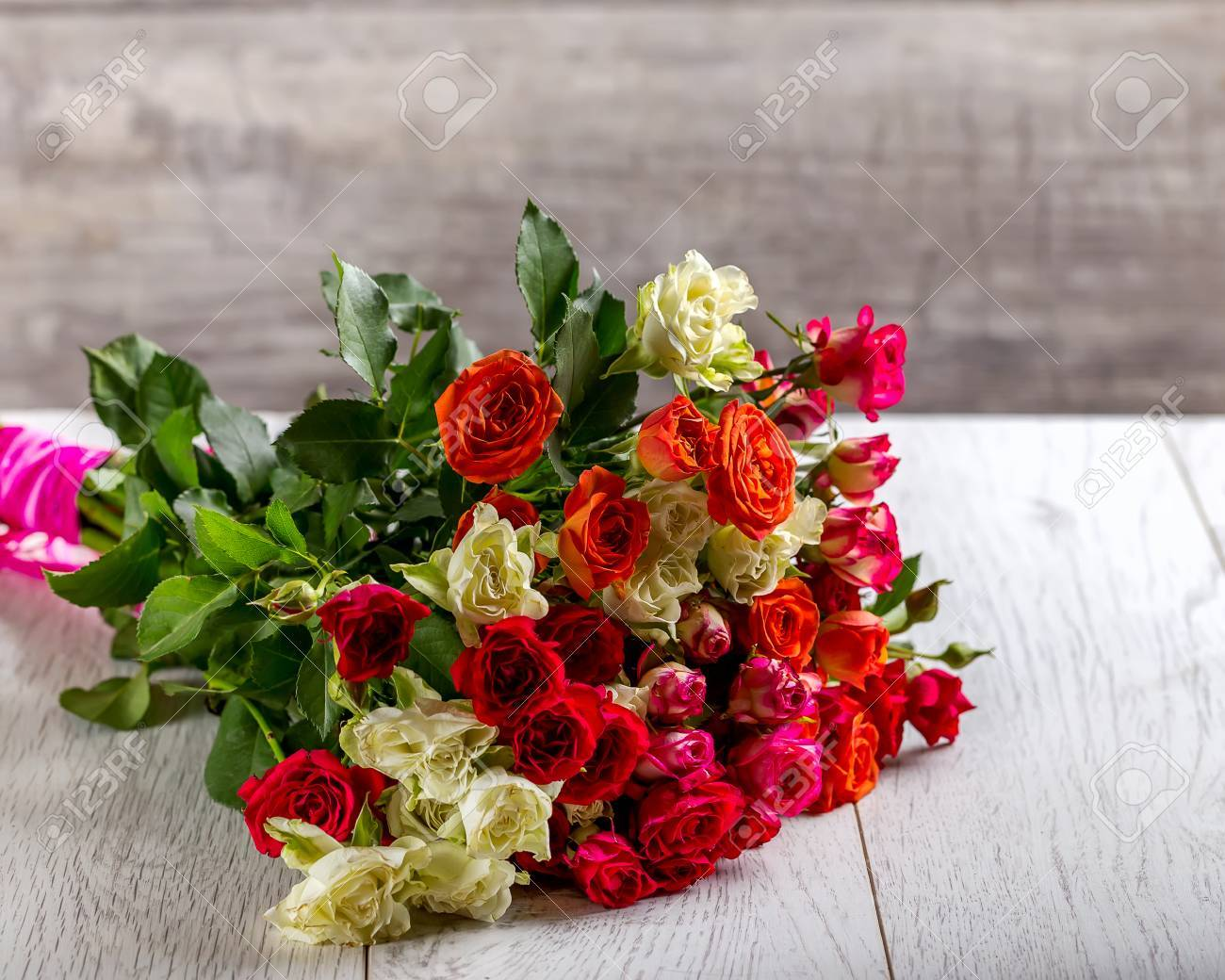 Bouquet Of Different Color Roses. Roses On The Table. Gray ...