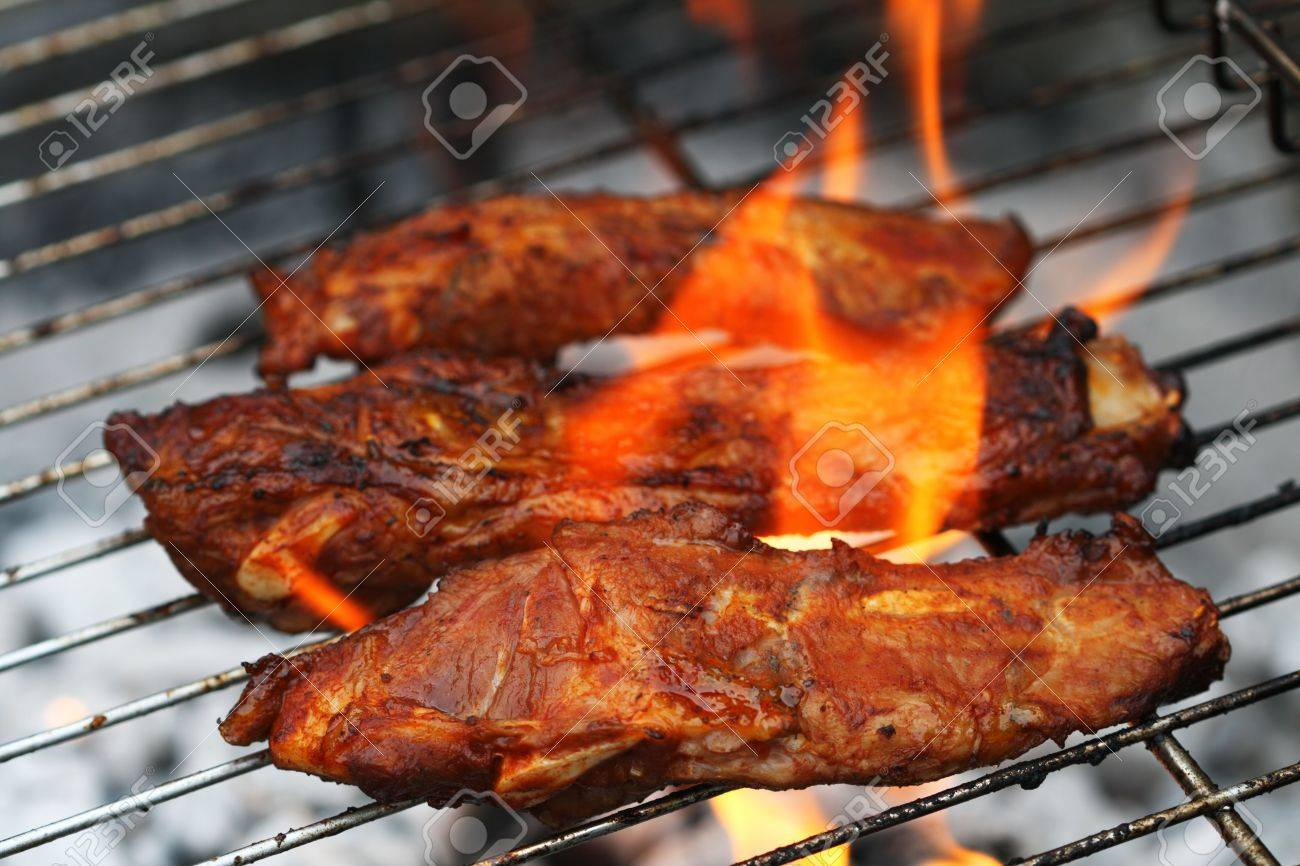 flame bbq marinated juicy pork ribs on griil summer barbeque