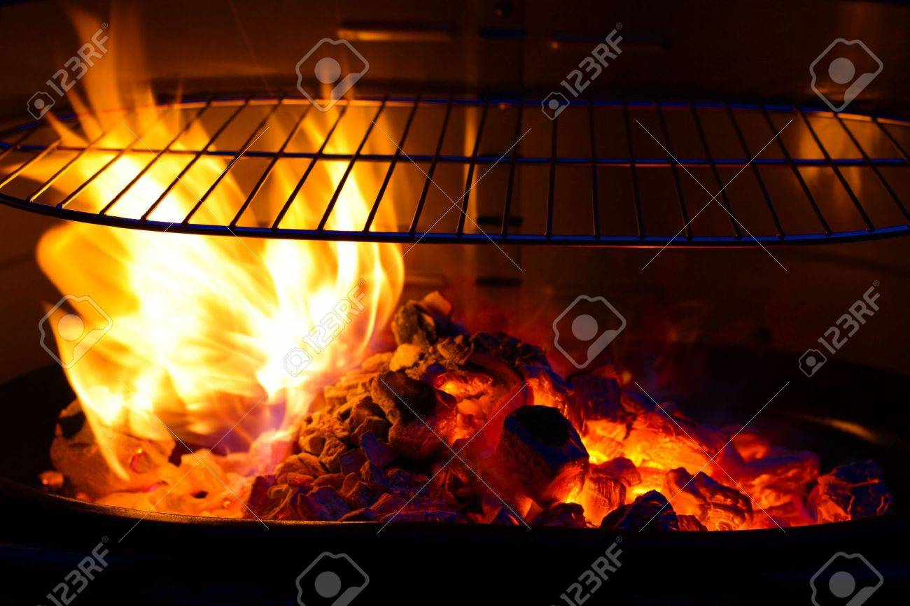 empty barbecue grill with flame and burning embers bbq colorful