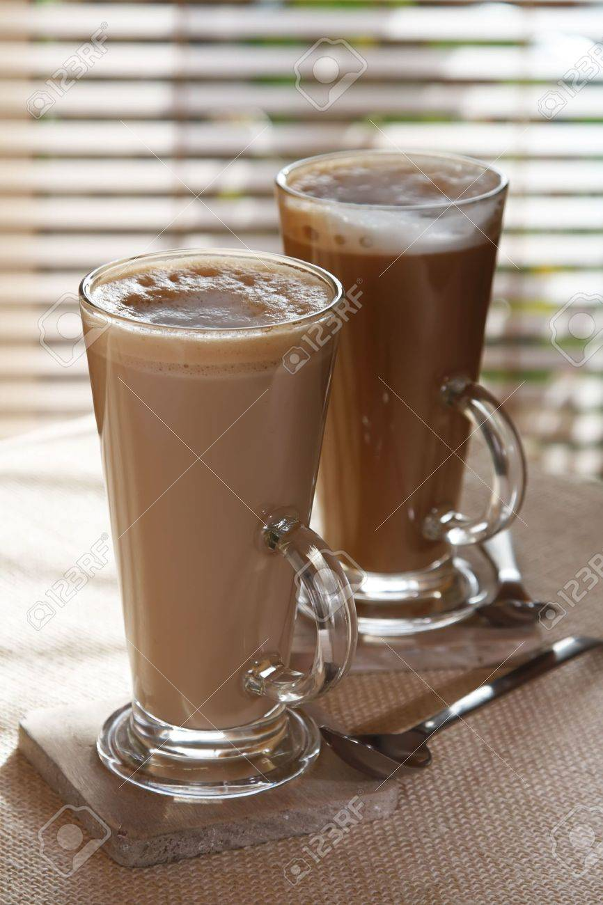 Coffee Latte Macchiato Or Hot Chocolate In Tall Glasses On Window ...