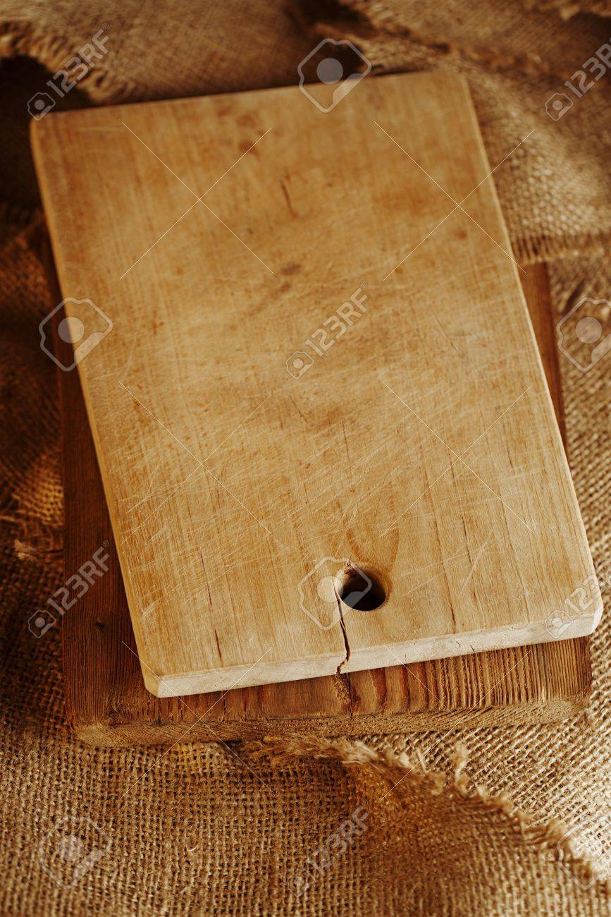 old woden choppig board on hessian backdrop, shallow dof Stock Photo - 16810353