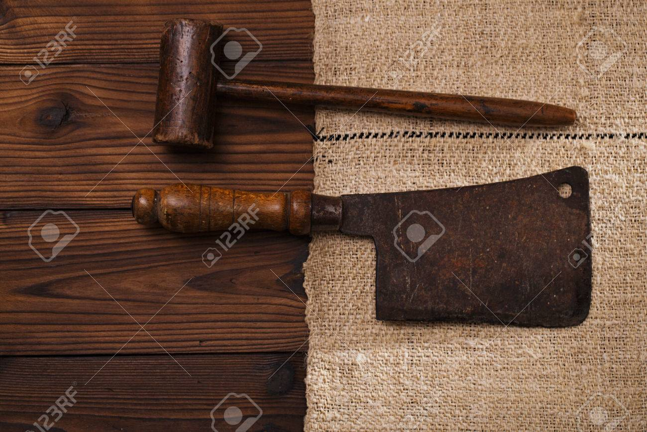 Real Vintage Wooden Mallet And Iron Meat Cleaver On Old Grain