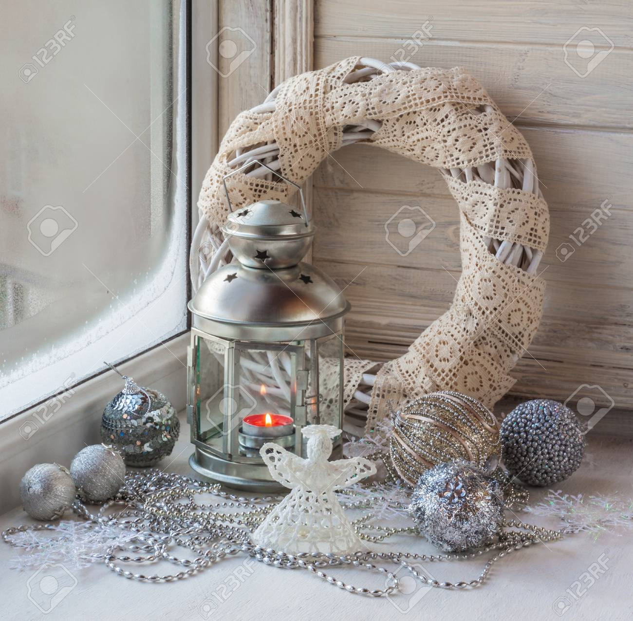 decorated christmas window decorations and lighted lantern on the eve of the first advent stock photo