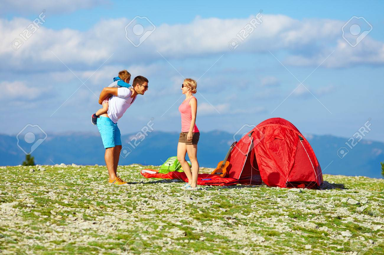 Happy Family Camping In Mountains Stock Photo