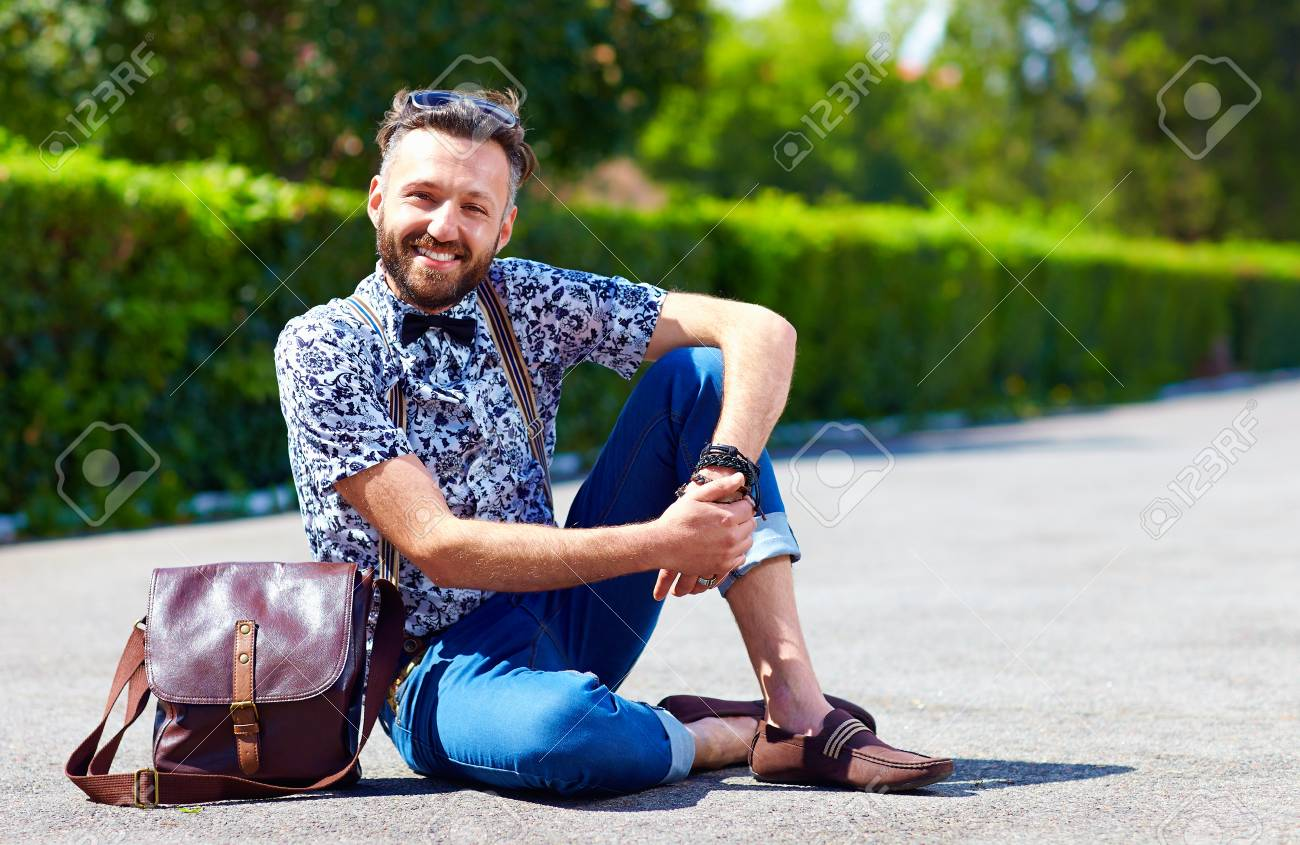 cheerful young adult man posing on the road