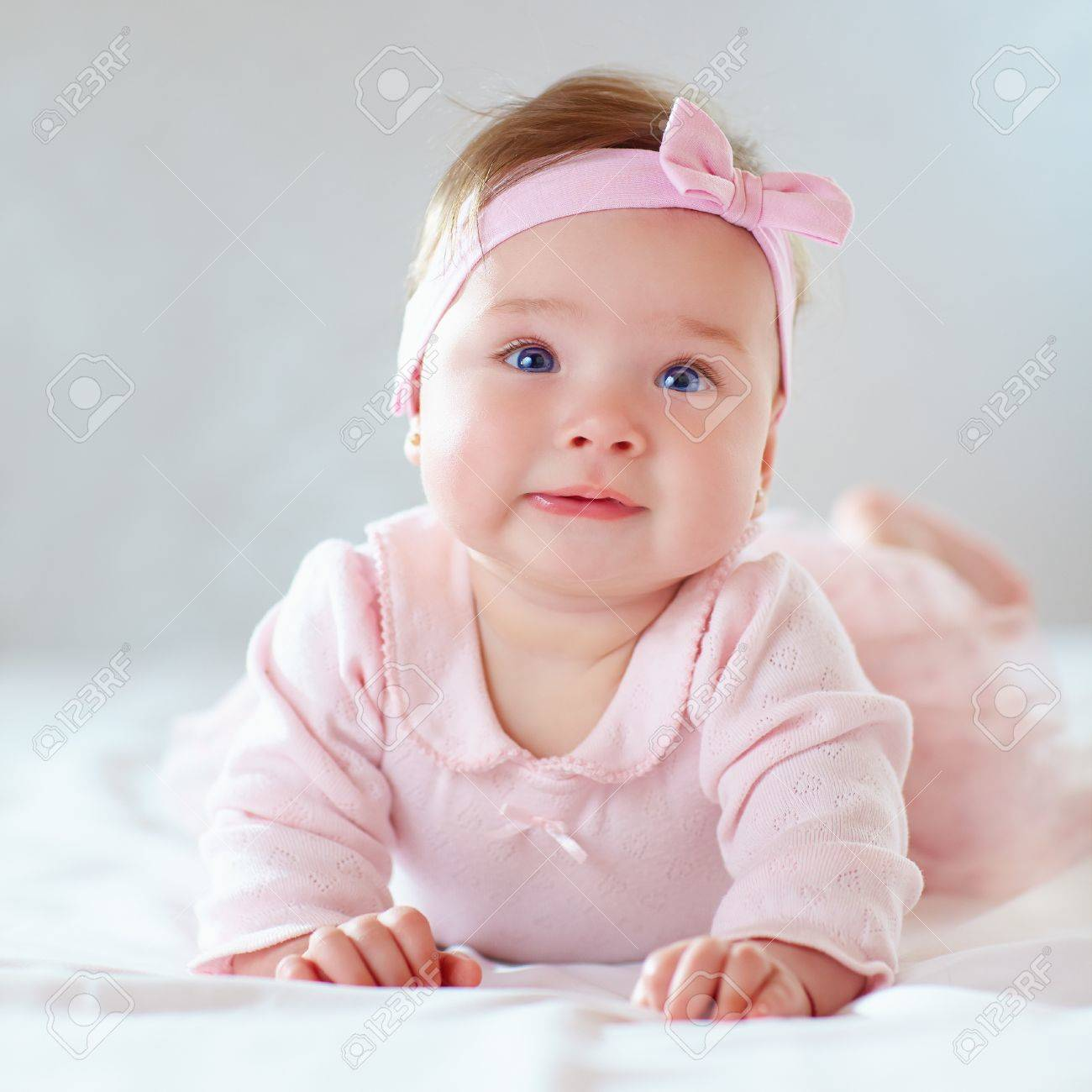 pretty baby girl in pink dress stock photo picture and royalty free