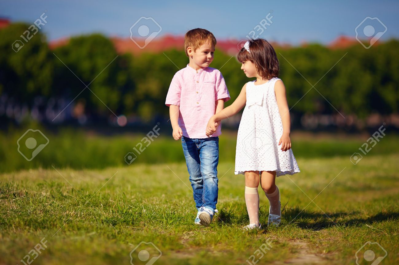 Cute Kids Couple Walking On Summer Field Stock Photo Picture And