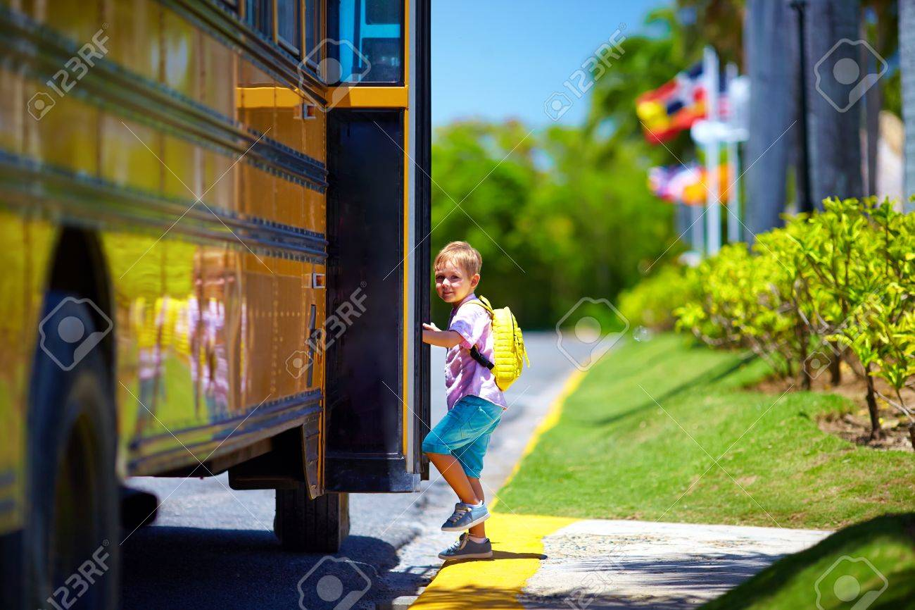 cute kid are getting on the bus, ready to go to school - 55857853