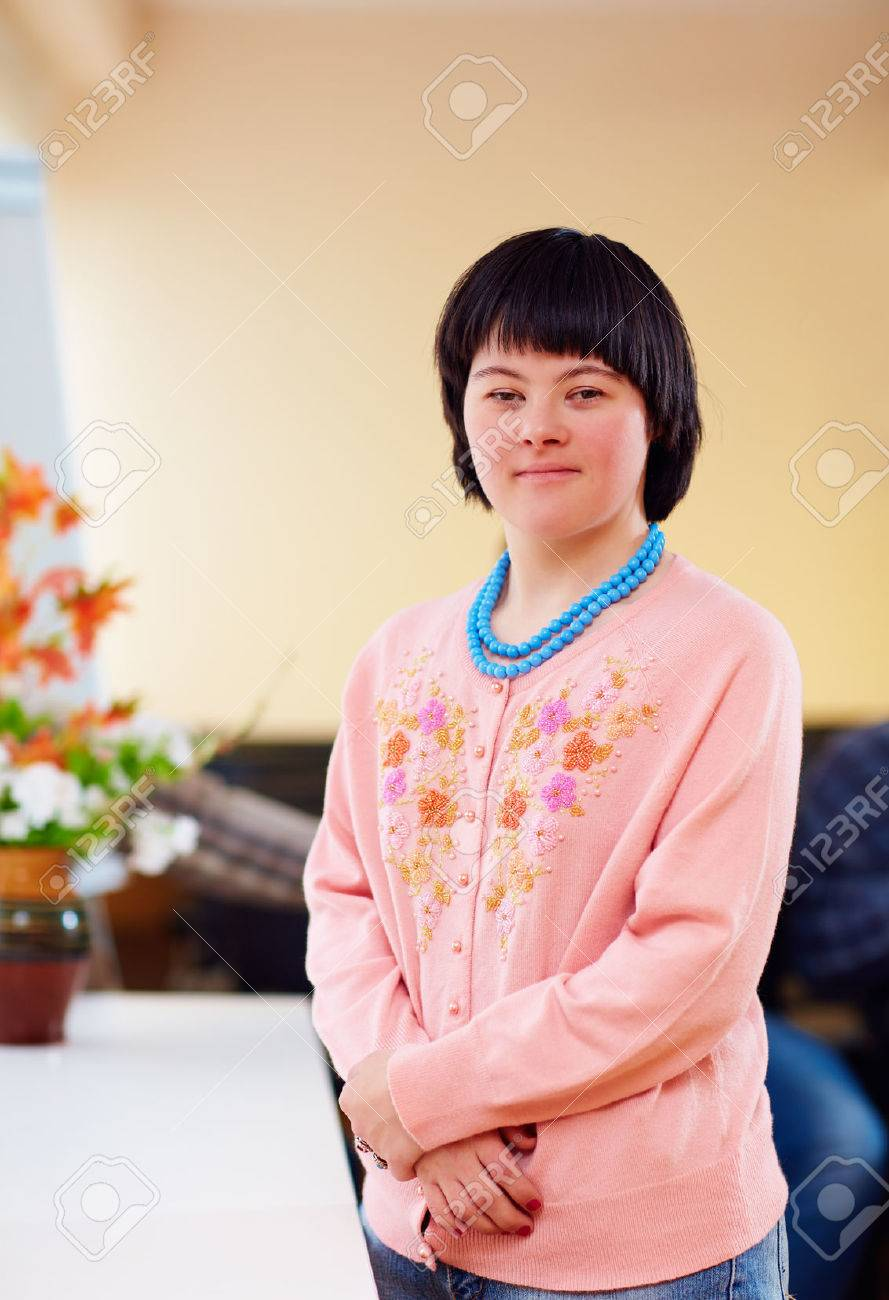 portrait of young adult woman with down's syndrome - 66532815