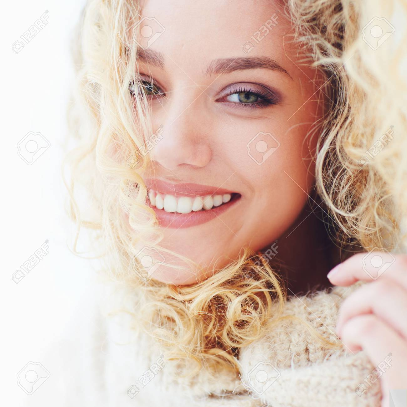 portrait of beautiful happy woman with curly hair and adorable smile - 72158635