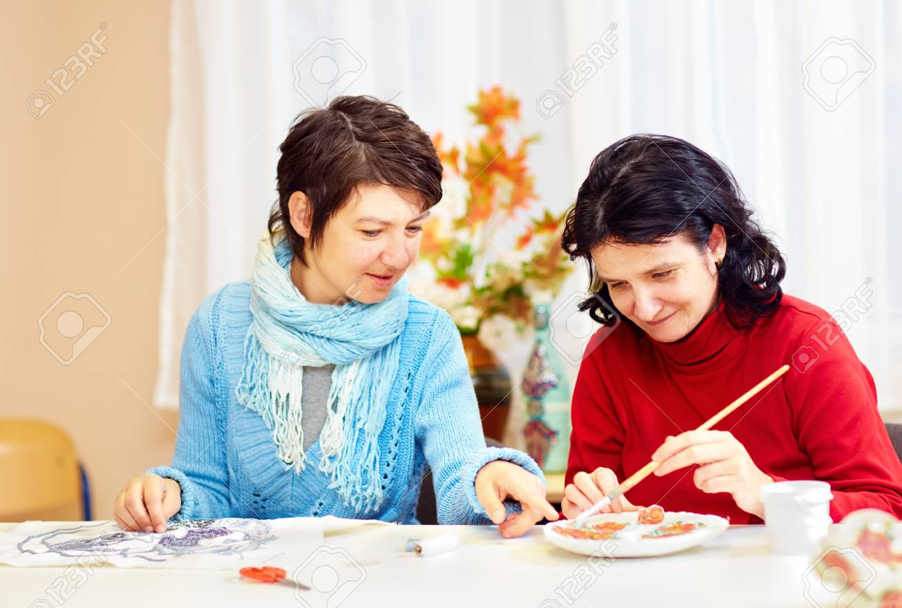 adult woman with special needs are engaged in handcraft in rehabilitation center - 75686378
