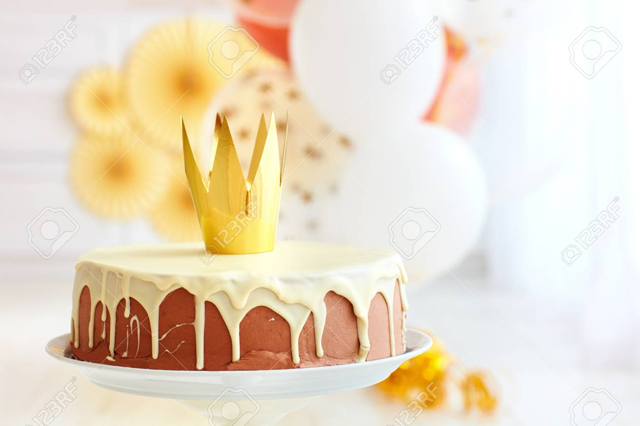 Yummy Birthday Cake With Golden Crown On Baby Party Background Stock