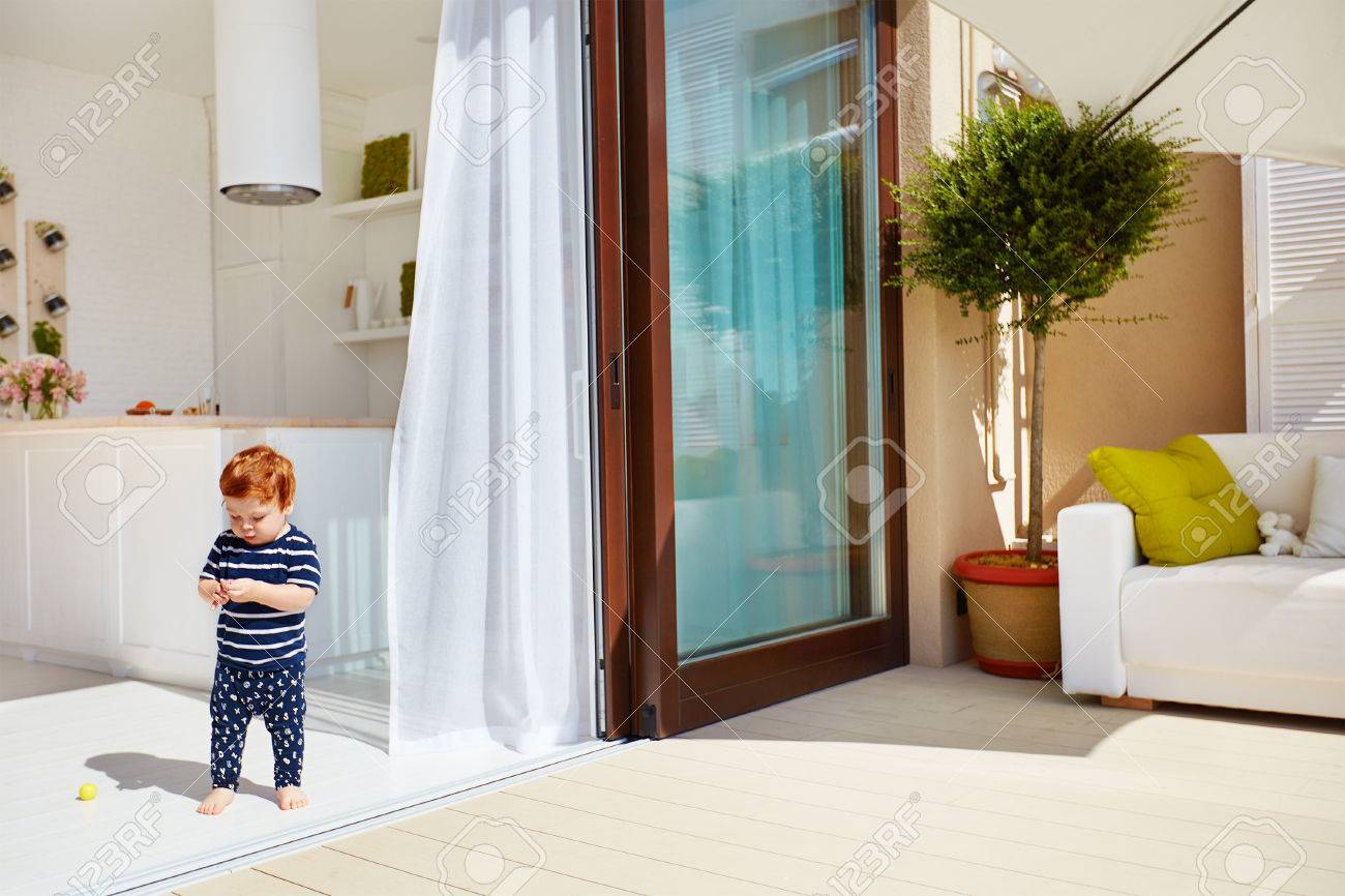 A Toddler Baby Walking On Open Space Kitchen With Roof Top Patio ...