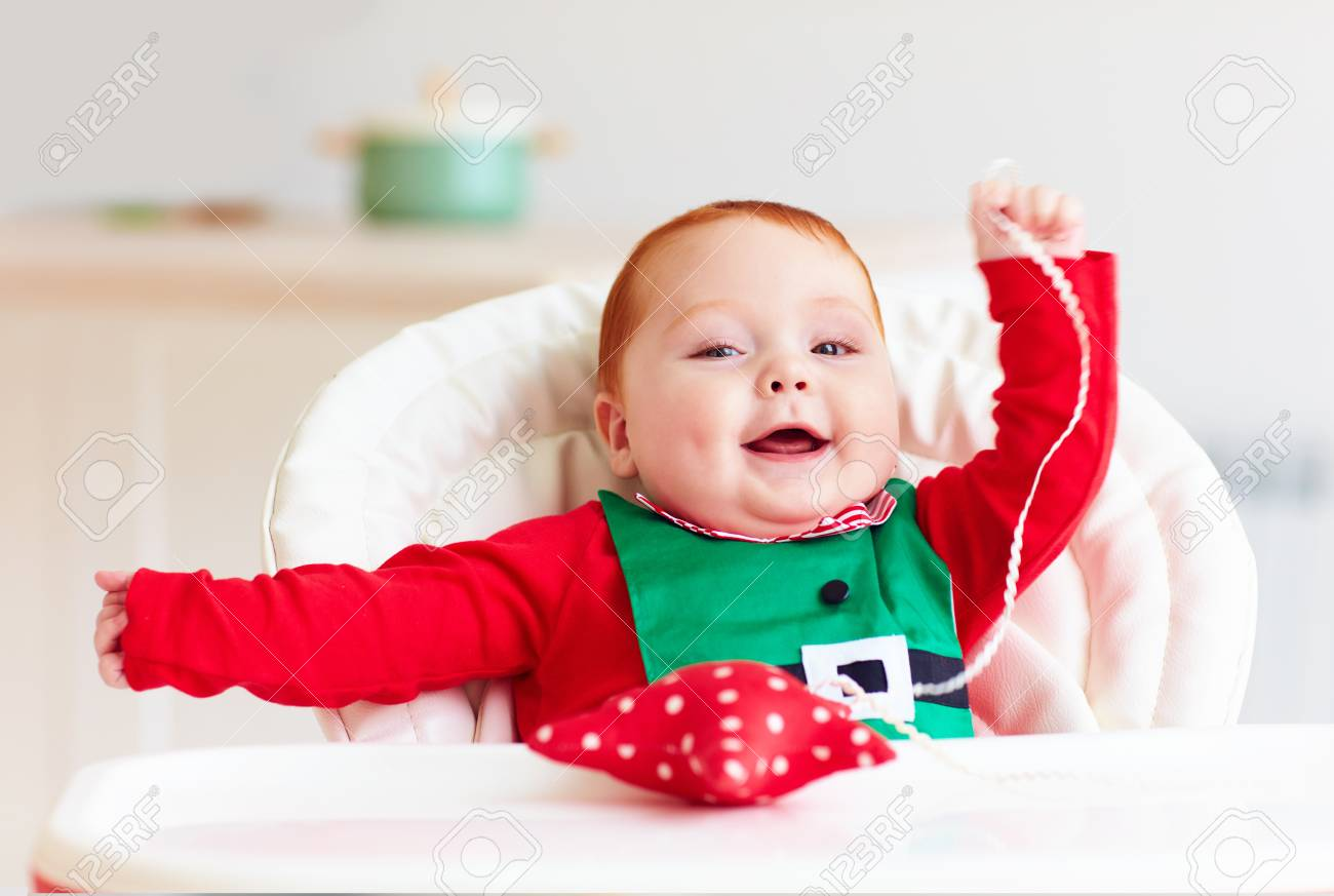 db21c76f0f47 Cute Infant Redhead Baby Boy In Elf Costume Playing With Red.. Stock ...