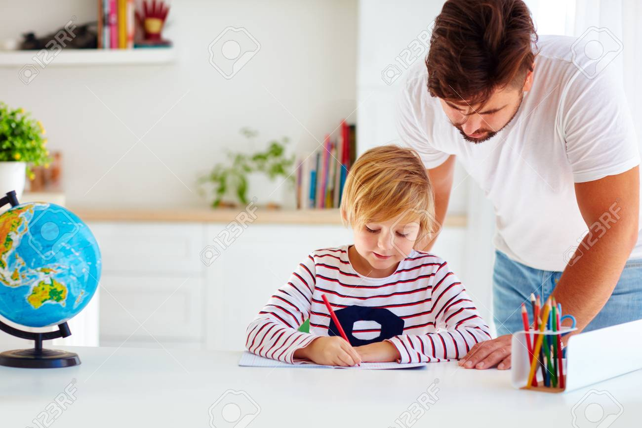 father and son at the desk, educating at home - 87406352
